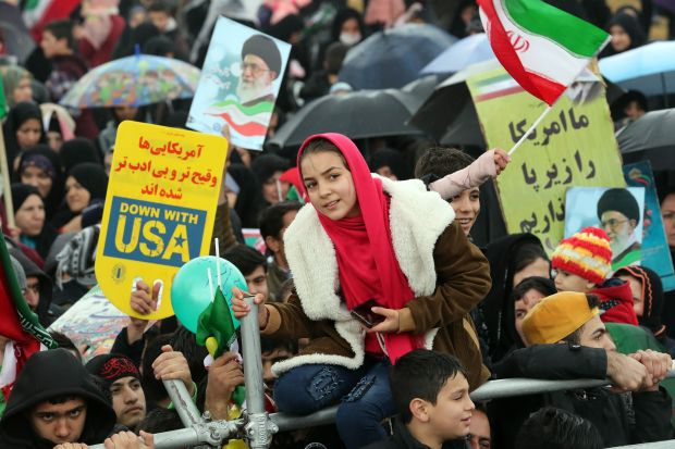Iranians carry anti-U.S. and anti-Israel banners and placards as they take part in a ceremony marking the 40th anniversary of the 1979 Islamic Revolution in Tehran.