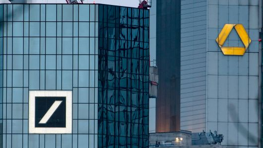 Picture taken on March 17, 2019 shows the headquarters of German banks Deutsche Bank (L) and Commerzbank in Frankfurt am Main, western Germany.