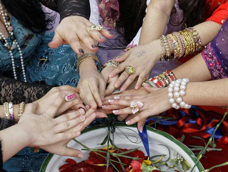 The hands of Romanian witches, during a Valentine's Day ritual in Mogosoaia, Romania, Monday, Feb. 14, 2011.