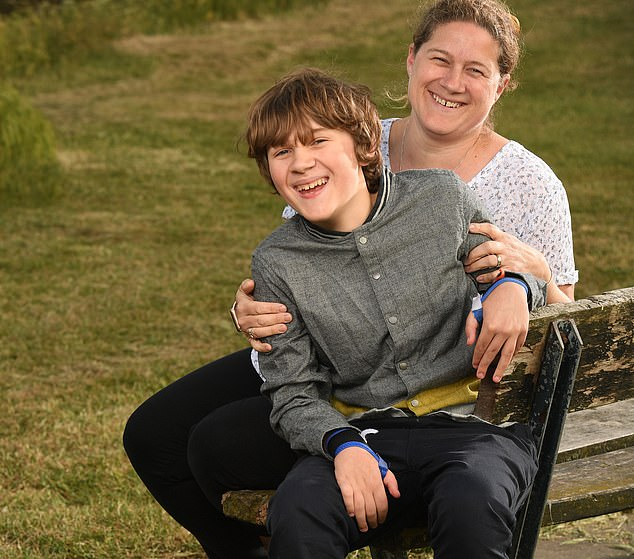 Now aged 14, Alex Roantree- Roesch's remains partially paralysed and struggles to talk. His future is uncertain. He is pictured with his motherAngela
