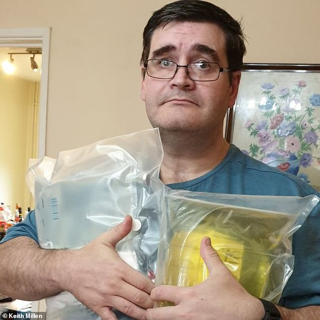 Keith Millen, 48, whose supply also stopped, said he was 'petrified' for his life. He is pictured holding a supply of intravenous nutrition at his home in Bridgend