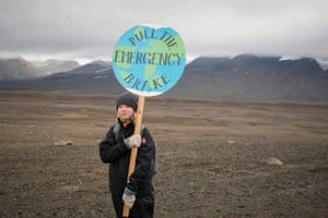 A girl poses with a placard walks to the plaque site.