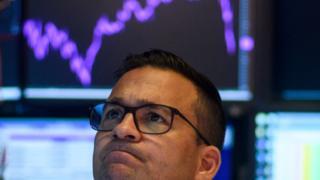 Trader looks worried