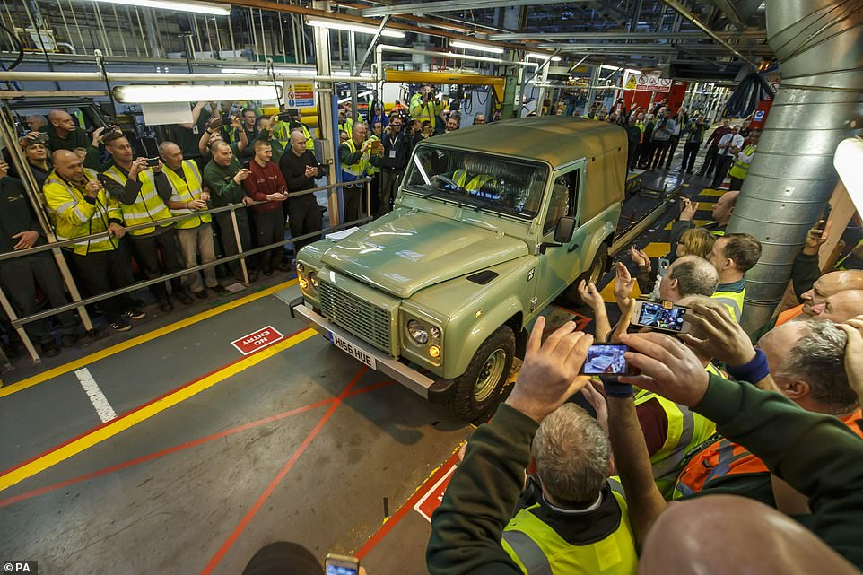 The final version of the previous-generation Land Rover Defender being driven off the production line on 29 January 2016