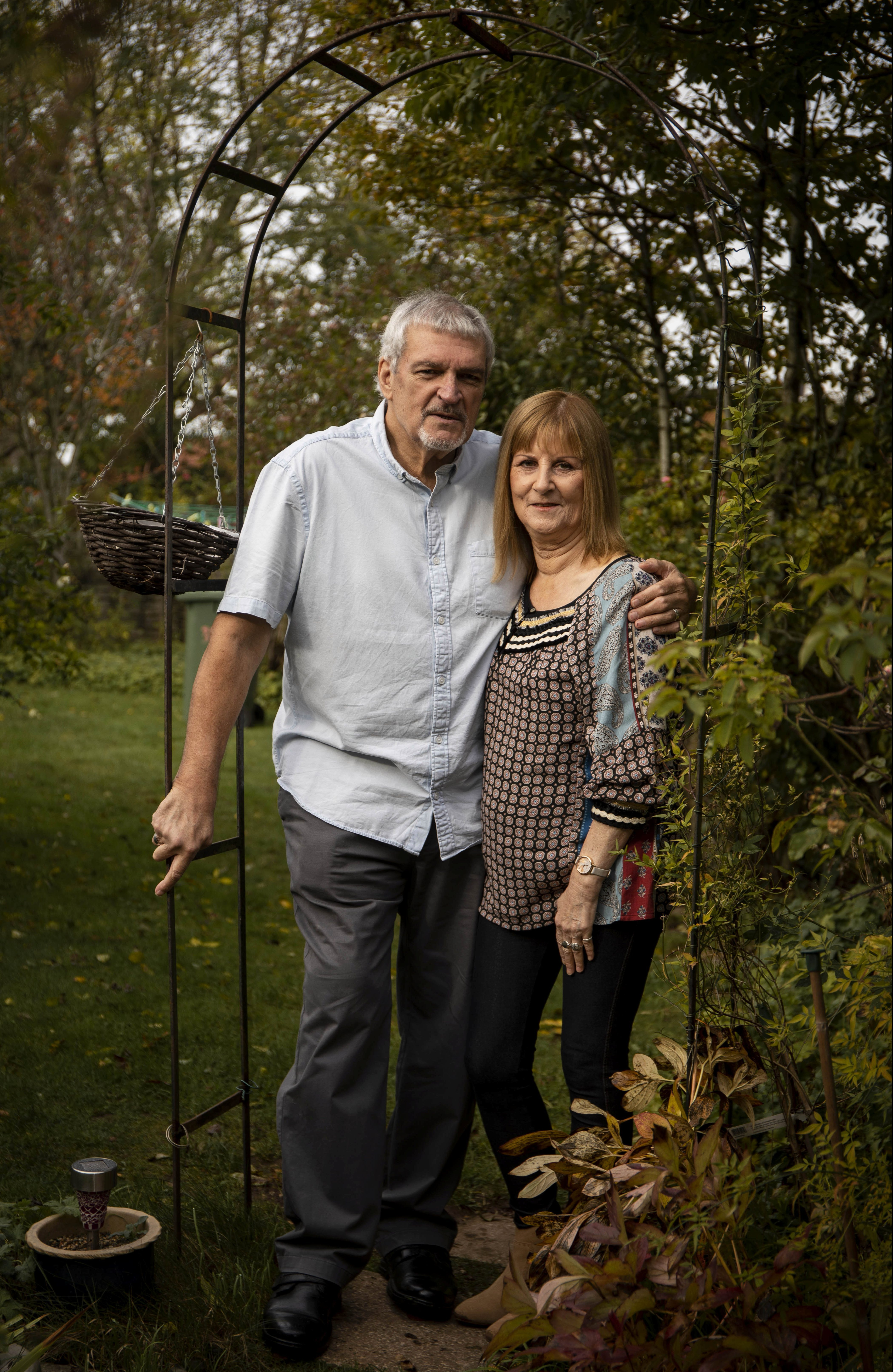 Shirley, with her husband Bob, in the garden where her cat, Chan, bit her