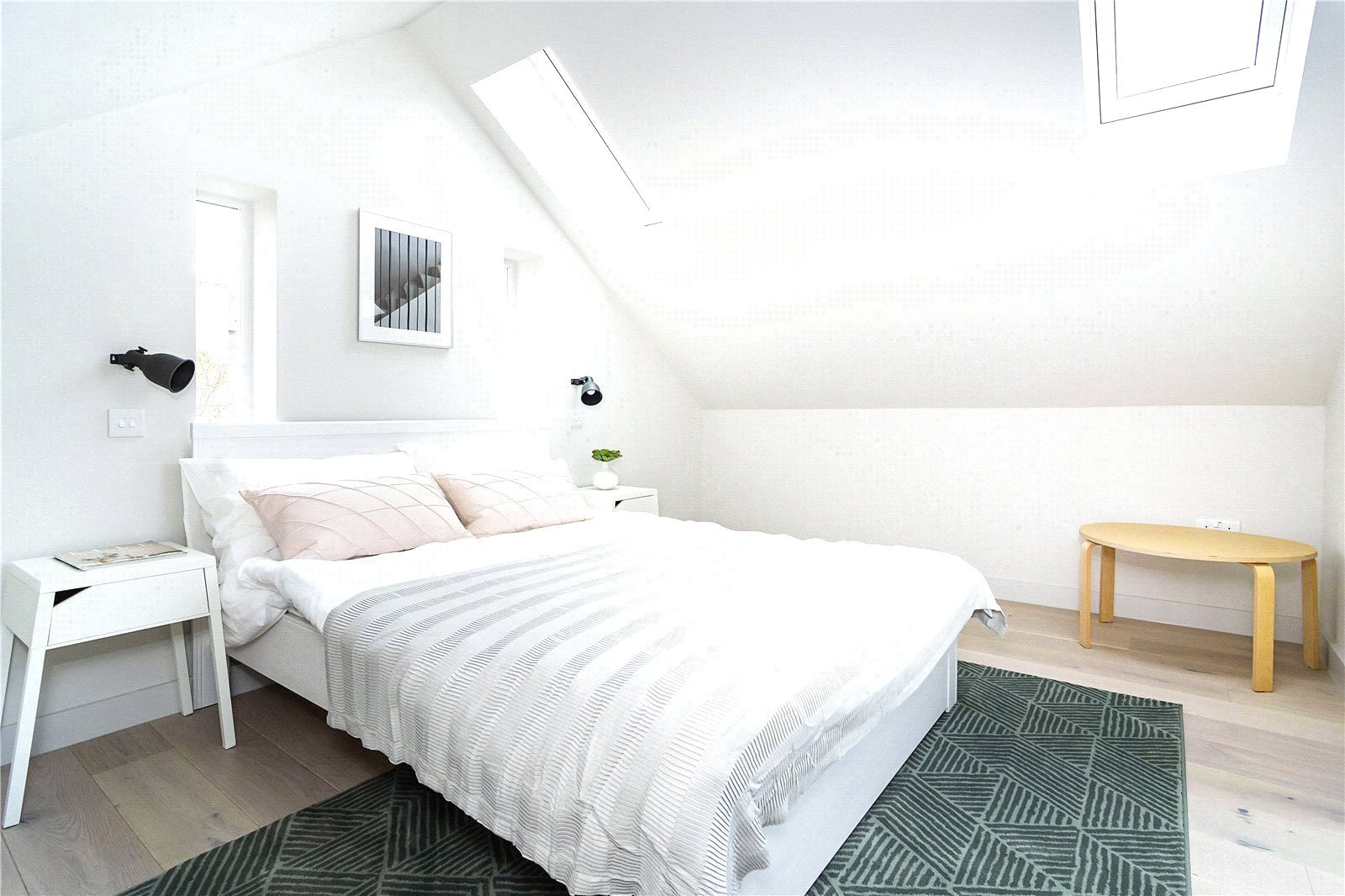 There's an airy bedroom on the mezzanine level