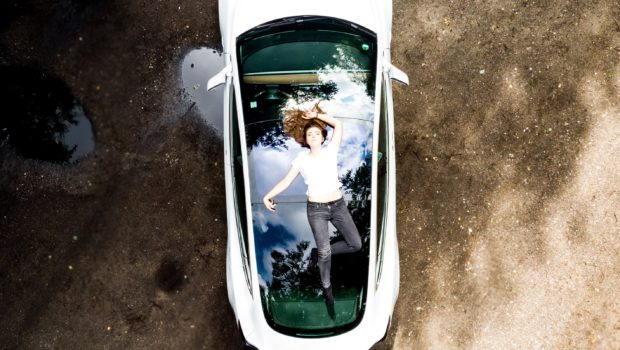 MaiOnHigh on top of her Model 3 .