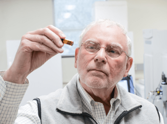 Professor John Giesy inspects a sample in his lab at the University of Saskatchewa Toxicology Centre (Image: Daniel Hallen/ USASK)