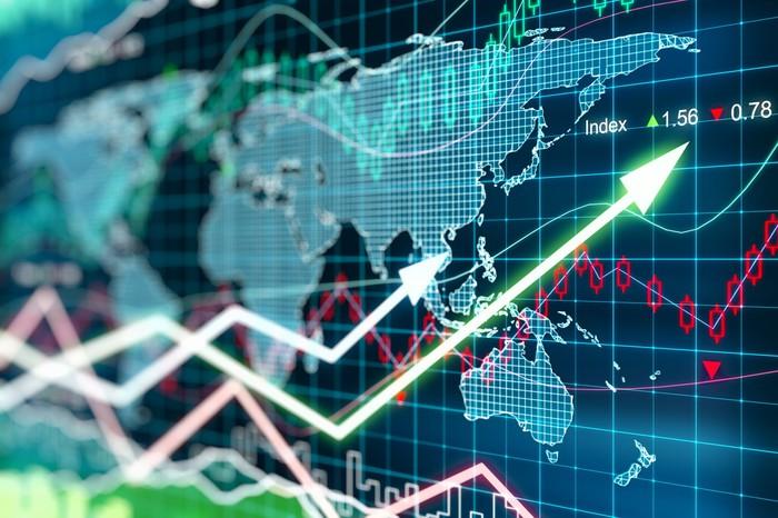 Digital world map with stock market charts indicating gains.
