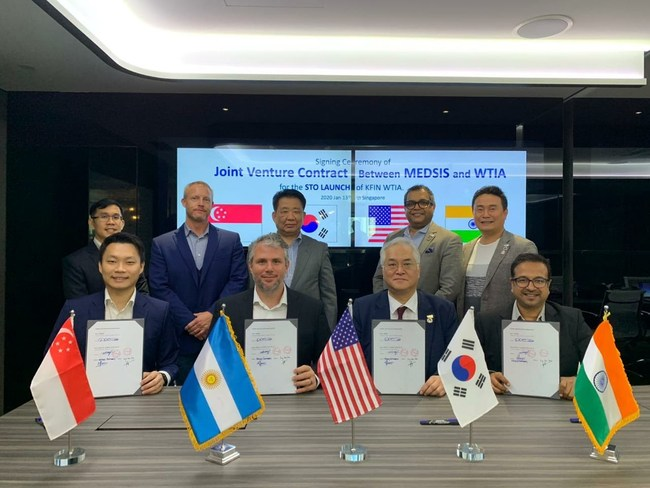 MEDSiS & WTIA sign an agreement to create a joint venture called Kfin WTIA and move towards the launch of their new STO. Back Row (left to right): Alvin Choy (Vision Group), Patrick Mulcahy (Medsis), Chairman Yongrae Choi, Rohan Britto (WTIA), Sun Moon Kim (WTIA) Front Row (Left to Right): Lim Hui Jie (Vision Group), Dax Cabrera (Medsis), Chairman Keun Young Kim (WTIA), Mitish Chitnavis (Payments 2.0)