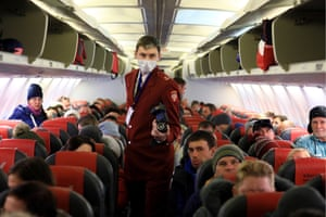 A Russian official uses a thermal imaging device to conduct a temperature check of passengers arriving at Krasnoyarsk airport on a plane from Vietnam.