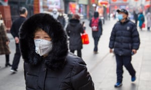 Masks are being widely worn in China, including in Beijing, as authorities struggle to contain the spread of coronavirus.