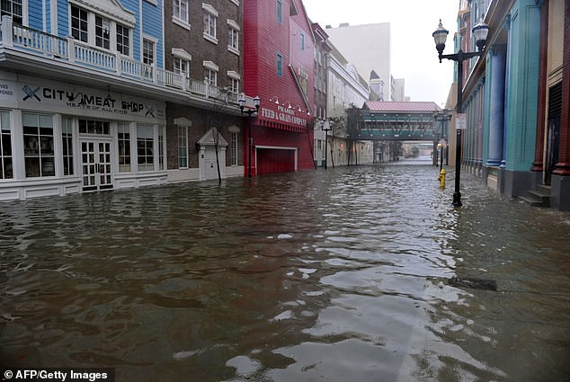 They also believe that hundreds of homes along the US coast will be flooded within the next few decades, such as Texas, Florida and New Jersey (pictured is a shot from Hurricane Sandy that hit the northeast in 2012) – all three have experienced major flooding over the past decade alone