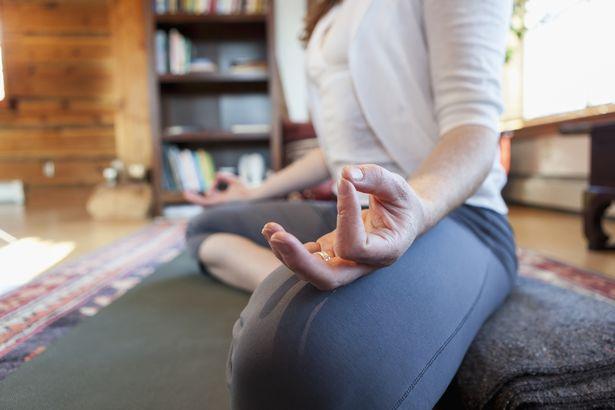 Woman practices yoga at indoor studio