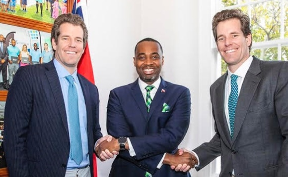 Bermuda premier David Burt shakes hands with Cameron and Tyler Winkelvoss, the twin brothers who founded cryptocurrency exchange Gemini