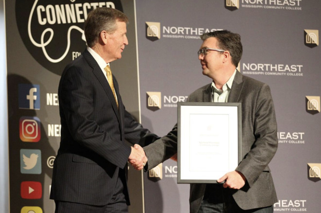 NEMCC President Ford accepting award from Apple's Jon Landis (photo credit Daily Journal)