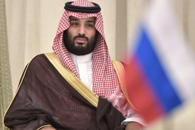 Saudi Arabia's Crown Prince Mohammed bin Salman sits in a chair with his hands on his knees.