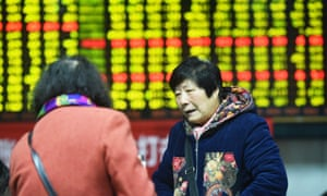 Investors at a stock exchange hall in Hangzhou, Zhejiang province, China.