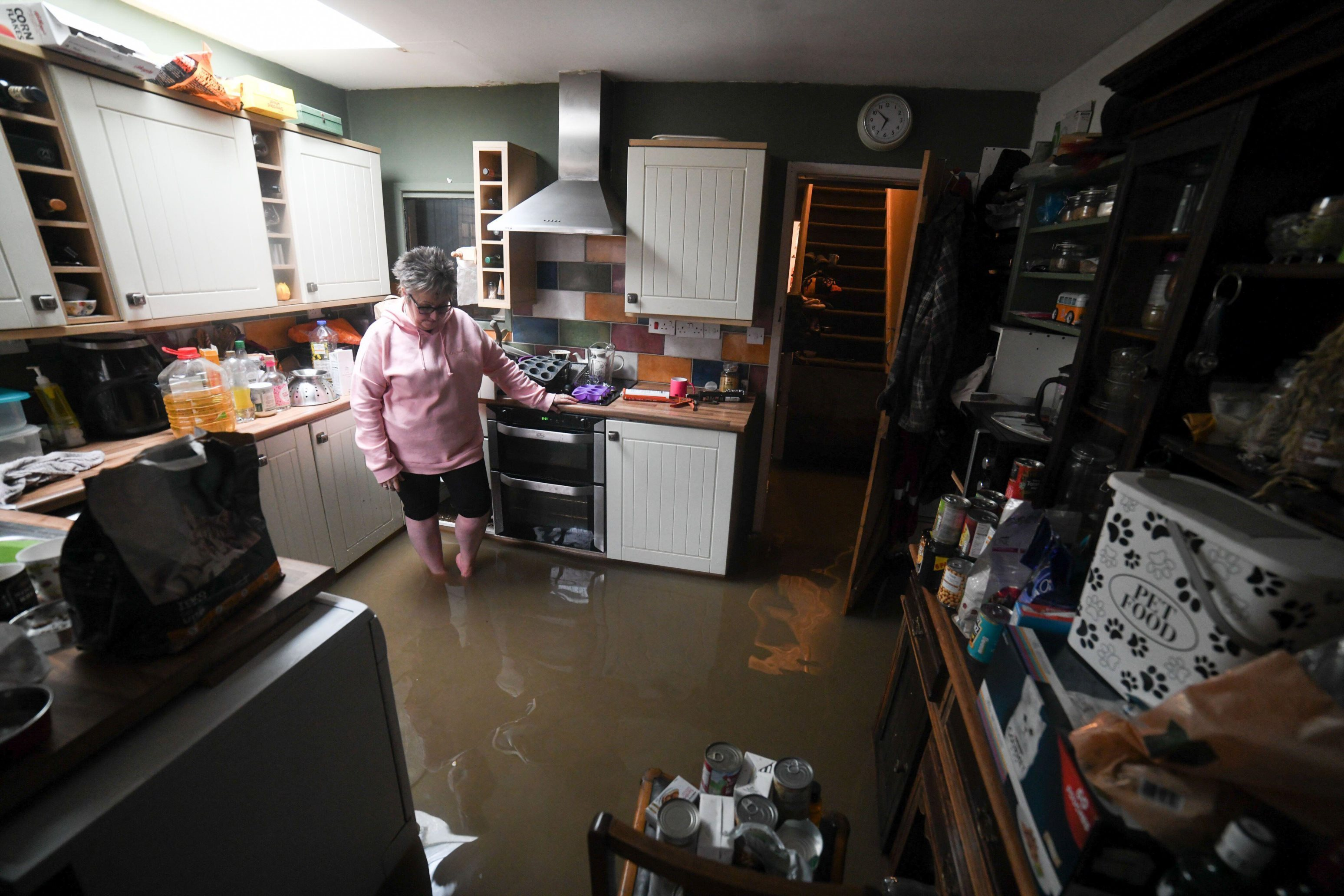 Jules Stewart's home in Canal Side in Aberdulais near Neath in South Wales, flooded after heavy rain overnight from Storm Dennis