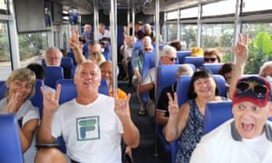 Passengers from the Westerdam cruise ship on a bus for a visit to the Cambodian capital Phnom Penh.