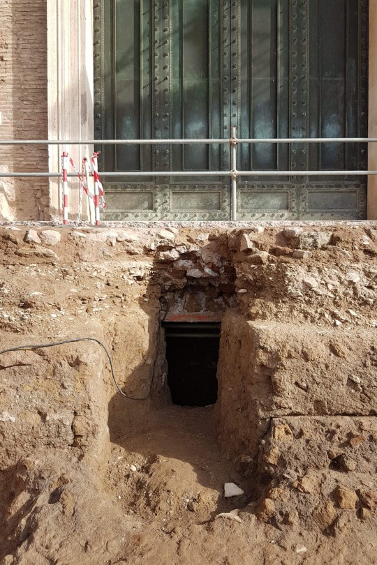 """This undated photo handout on February 21, 2020 by the Archaeological Park of the Colosseum (Parcolosseo) in Rome shows the access to a chamber where an ancient tomb is thought to belong to Rome's founder Romulus, at the Curia - Comitium in Rome. - An ancient tomb thought to belong to Rome's founder Romulus will be presented to the world on February 21, 2020, bringing to a head months of investigation by history sleuths. The 6th century BC stone sarcophagus, with an accompanying circular altar, was discovered under the Forum in the heart of Italy's capital decades ago, but experts could not agree on whether or not it belonged to the fabled figure. (Photo by Handout / ARCHAEOLOGICAL PARK OF THE COLOSSEUM - PARCOLOSSEO / AFP) / RESTRICTED TO EDITORIAL USE - MANDATORY CREDIT """"AFP PHOTO / ARCHAEOLOGICAL PARK OF THE COLOSSEUM - PARCOLOSSEO"""" - NO MARKETING NO ADVERTISING CAMPAIGNS - DISTRIBUTED AS A SERVICE TO CLIENTS --- (Photo by HANDOUT/ARCHAEOLOGICAL PARK OF THE COLOS/AFP via Getty Images)"""