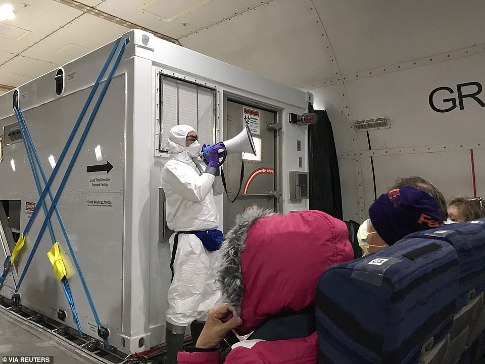 The State Department confirmed that, after the evacuees had been placed on buses to the airport, 14 people who were not showing symptoms had tested positive for the virus - and were then placed into isolation chambers (pictured)