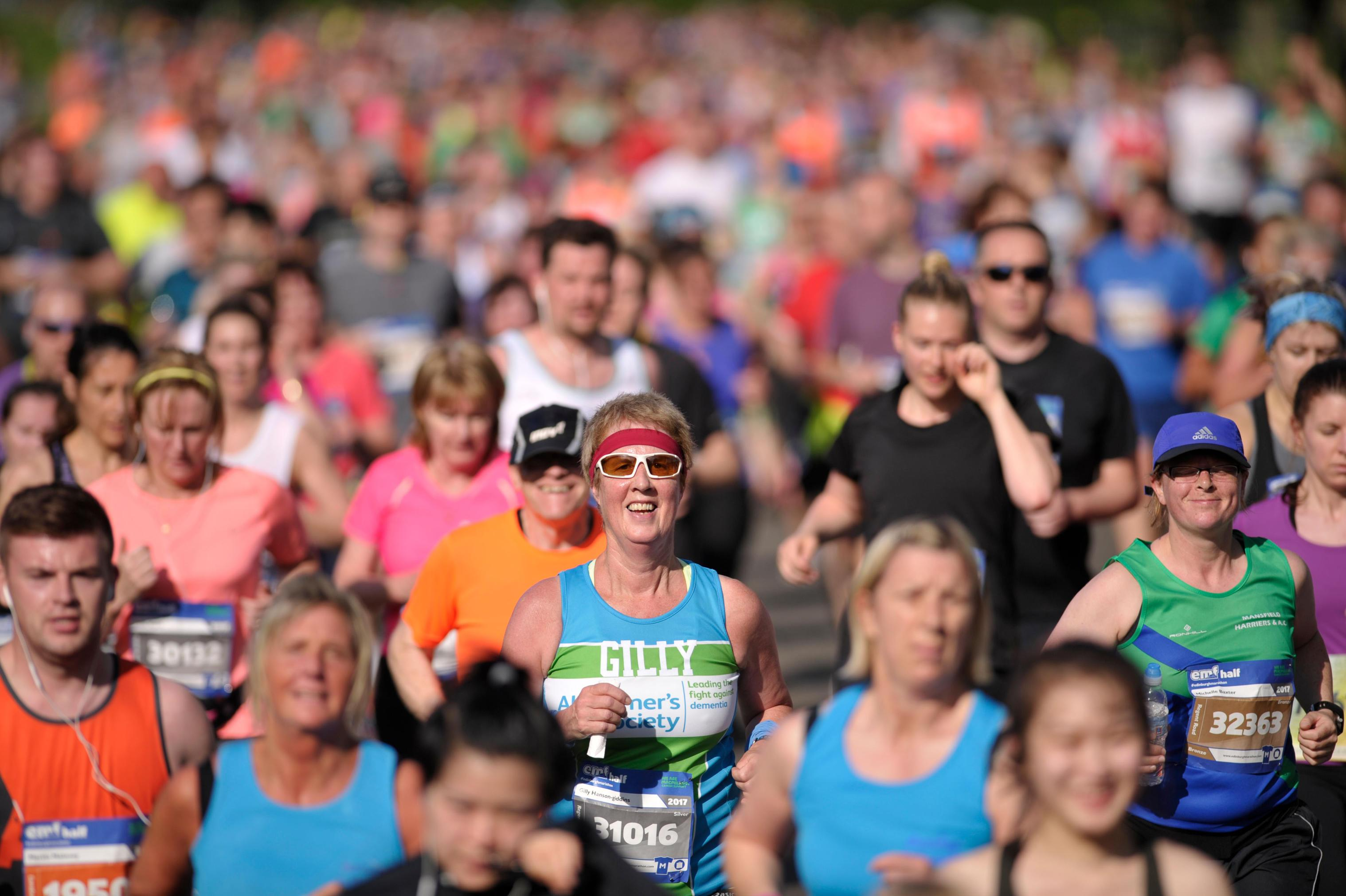 Thousands of runners make their way through Edinburgh for the Edinburgh Marathon Festival