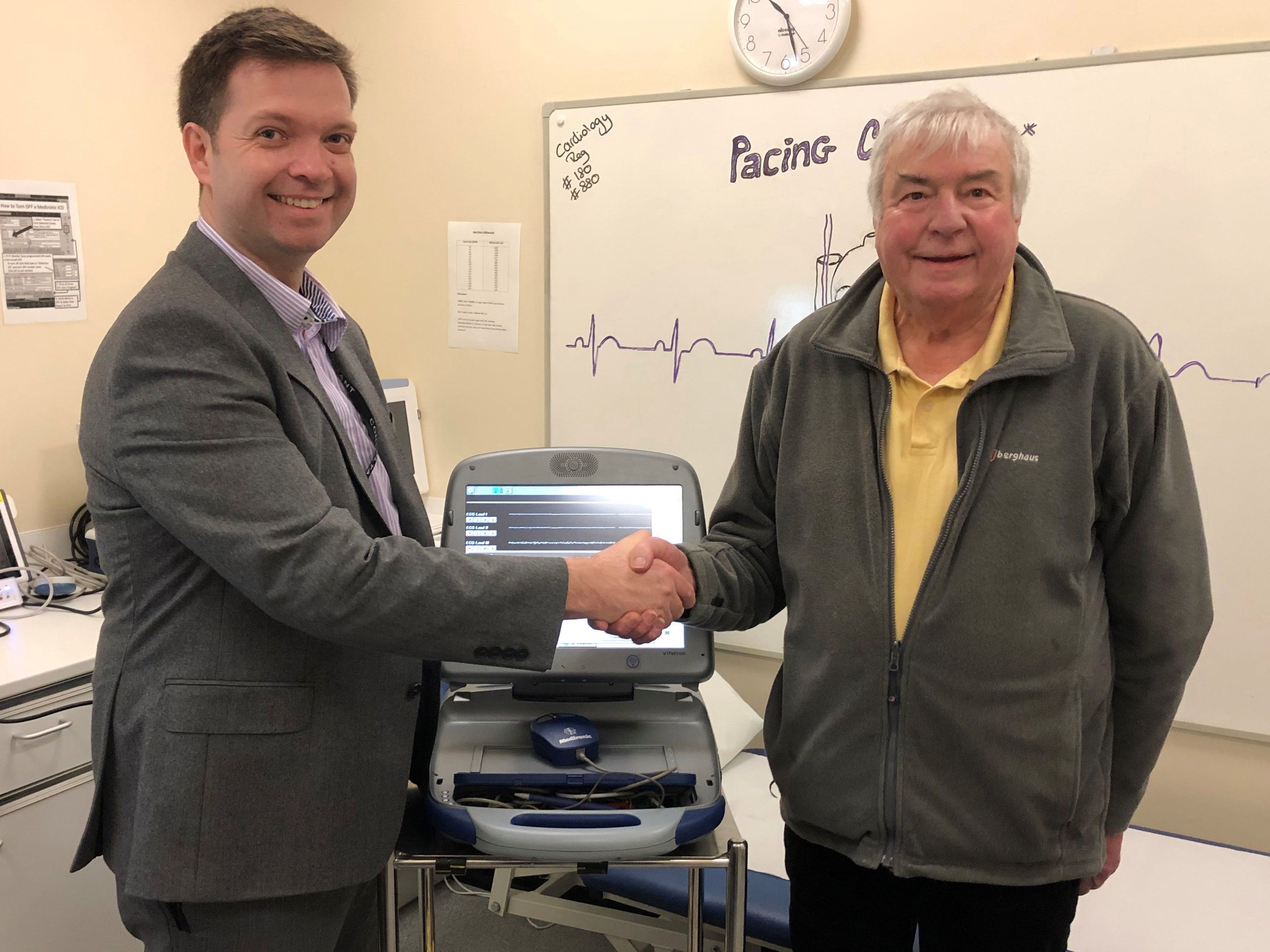 David Southworth, with his surgeon Dr Duncan Field, is the first patient to be monitored through a heart implant that can call his doctor on a smartphone