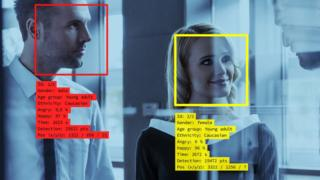 Concept graphic showing a man and a woman detected by facial recognition software