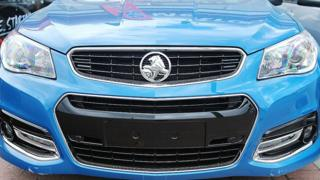 A new Holden vehicle stands for sale at a dealership at Thebarton on July 30, 2013 in Adelaide, Australia.