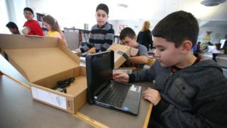 Pupils in California open new Chromebook laptop computers