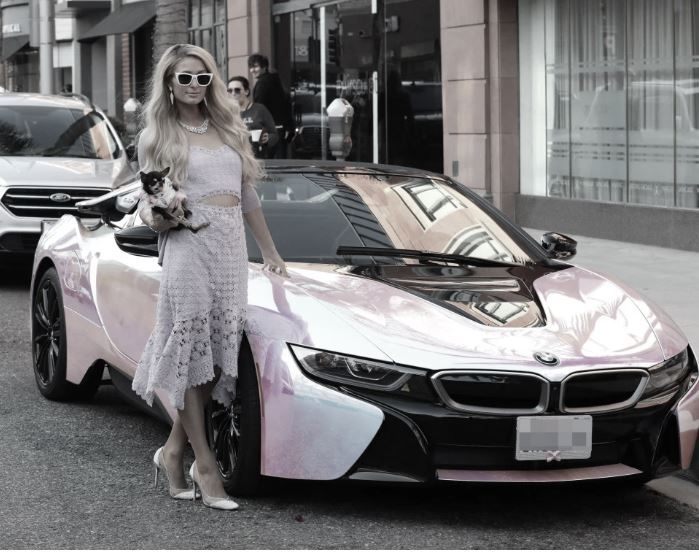 Paris Hilton posing in front of her customised $165,000 BMW i8 Roadster