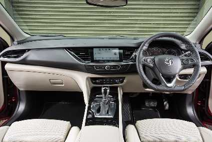The touchscreen replaces a myriad of buttons found on the previous Insignia.