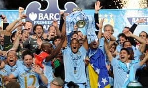 Man City v QPR<br>Manchester City v Quees Park Rangers, F.A. Premier League match, Etihad Stadium, Manchester. 13/5/12. Pic: Tom Jenkins. Vincent Kompany lifts the Premier League trophy.