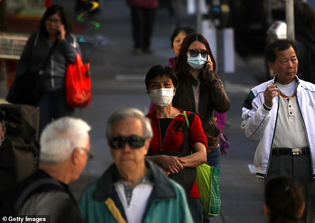 Panic has causes thousands of people across the globe to stock up on face mask over fears of the coronavirus outbreak. Pictured: People wear surgical masks in San Francisco's Chinatown on February 26
